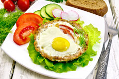 Tartlet meat with egg on board Royalty Free Stock Photography