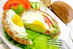 Tartlet meat with egg cut on board Royalty Free Stock Photo