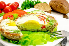 Tartlet meat with egg cut and vegetables on board Royalty Free Stock Images