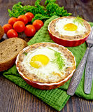 Tartlet meat with egg in pan on dark board Royalty Free Stock Images