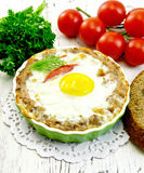 Tartlet meat with egg in pan on light board Stock Image