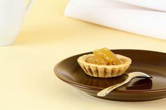 Tartlet with peach jam Stock Photos