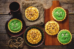 Tartlet with pumkin and spinach cream for Halloween Royalty Free Stock Photo