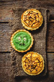 Tartlet with pumkin and spinach cream for Halloween Royalty Free Stock Images