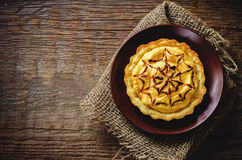 Tartlet with pumpkin cream for Halloween for kids Royalty Free Stock Image