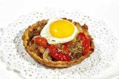 Tartlet with quail egg Stock Photos