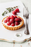 Tartlet with raspberries. Tartlet with fresh raspberries and fork Stock Image
