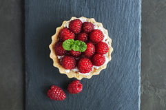 Tartlet with raspberries. On a slate board background Stock Photo