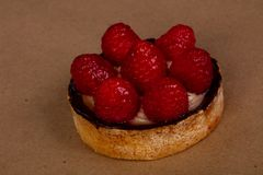 Tartlet with raspberry. And cream Royalty Free Stock Photo