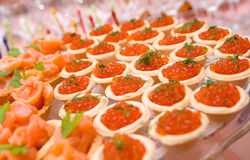 Tartlet with red caviar Stock Images