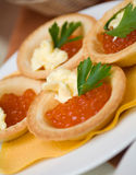 Tartlet with red caviar Stock Image