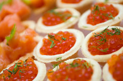 Tartlet with red caviar Stock Photography