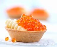 Tartlet with red caviar closeup Stock Image