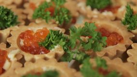 Tartlet with red caviar on the festive table HD. Tartlet with red caviar on the festive table stock footage