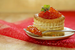Tartlet with red caviar on plate. Royalty Free Stock Images