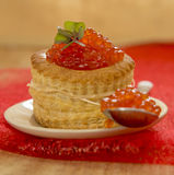 Tartlet with red caviar on plate. Stock Images