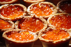Tartlet with red salmon caviar. On a plate Stock Photography