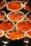 Tartlet with red salmon caviar Stock Photography