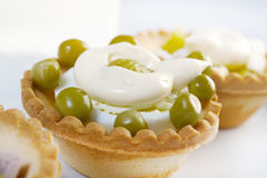 Tartlet with salad on a white plate Stock Photography
