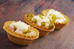 Tartlet with salad on wooden board Stock Images