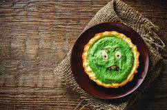 Tartlet with spinach cream for Halloween in the form of a monste Stock Image