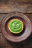 Tartlet with spinach cream for Halloween in the form of a monste Stock Photography