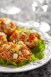 Tartlet stuffed with salmon salad Stock Images
