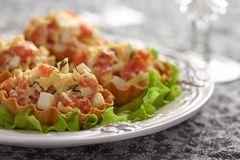 Tartlet stuffed with salmon salad Stock Photo