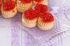Tartlets. Delicious tartlets with red caviar Royalty Free Stock Photo