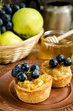 Tartlets with apple, grapes and honey Royalty Free Stock Image