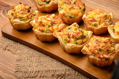 Tartlets Baked With Mashed Potato, Cheese, Ham And Parsley. Stock Photo