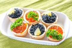 Tartlets with black and red caviar Royalty Free Stock Image