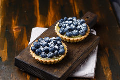 Tartlets with blueberries and lemon custard Royalty Free Stock Images
