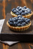 Tartlets with blueberries and lemon custard Stock Photos