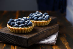 Tartlets with blueberries and lemon custard Stock Images