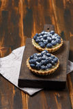 Tartlets with blueberries and lemon custard Royalty Free Stock Photos