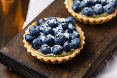 Tartlets with blueberries and lemon custard Royalty Free Stock Photo