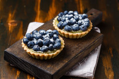 Tartlets with blueberries and lemon custard Royalty Free Stock Image