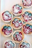 Tartlets with blueberries and raspberry. Small tarts with fruits. Tartlets with blueberries and raspberry. Small tarts with fruits Stock Photo