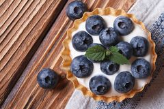Tartlets with blueberries on wooden view from above Stock Photo