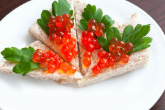 Tartlets with caviar and parsley on a plate. See my other works in portfolio Stock Photos
