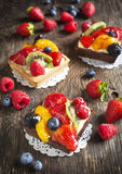Tartlets with chantilly cream and berries Stock Photography