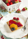Tartlets with chantilly cream and berries Stock Photo