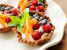 Tartlets with cheese and berries Royalty Free Stock Photos
