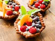Tartlets with cheese and berries Stock Photos