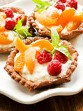 Tartlets with cheese and berries Stock Photo