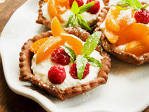 Tartlets with cheese and berries Stock Photography