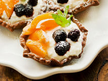 Tartlets with cheese and berries Royalty Free Stock Image