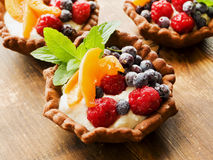 Tartlets with cheese and berries Royalty Free Stock Photography