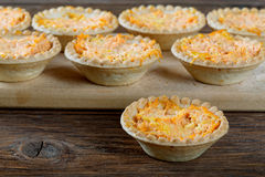 Tartlets with cheese and carrots Stock Photography